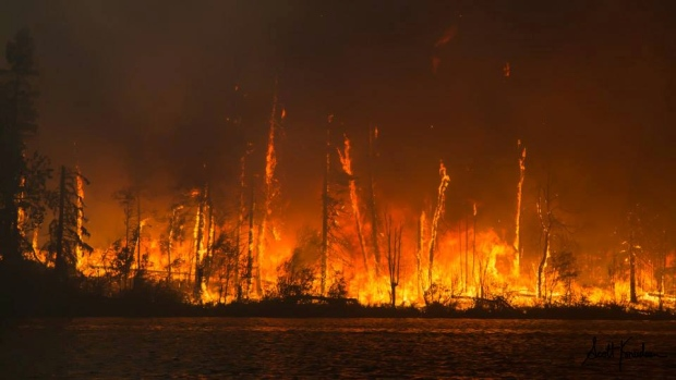 B.C. and the Prairies have been scorched by wildfires this year. Here, a fire tears through a peninsula jutting out onto Lac La Ronge, Sask., in July. (Submitted by Scott Knudsen, Northscape Photography )