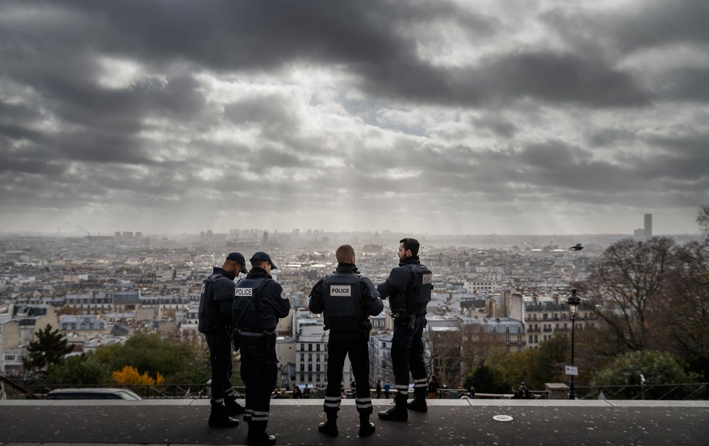Paris is seen as French Police officers stand on guard near the church of Sacre Coeur, on top of the Montmartre hill, in Paris, Wednesday, November 18, 2015. (AP Photo / Daniel Ochoa de Olza)