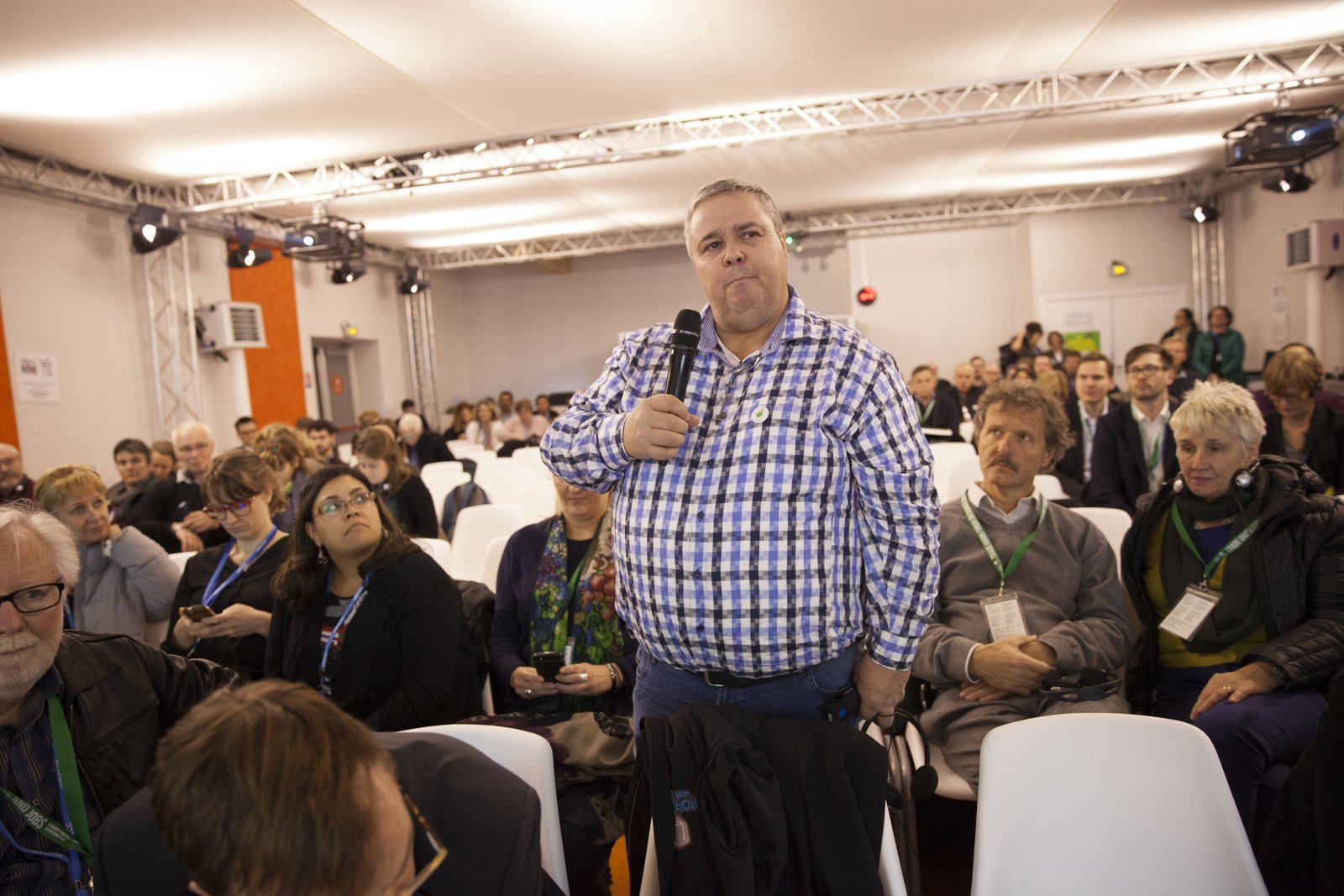 """Suncor oil sands mechanic Ken Smith speaks to """"One Million Climate Jobs"""" event at COP21 summit in Paris on Thursday. Source: the National Observer; photo by Mychaylo Prystupa"""
